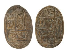 https://flic.kr/p/evCNdo | Sadigh Gallery's Ancient Egyptian Limestone Heart Scarab | Brown limestone heart scarab with a winged beetle, an Eye of Horus, a bird and the sun God Ra on the top. Three columns of various Egyptian symbols on the bottom. 26th Dynasty. 663-525 BC
