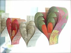 Autumn Paper Hearts Garland Banner Vintage Sheet Music French Paperie Kissed Mango Sangria Hand Crafted Large Hearts Tangerine Photo Props. $42.00, via Etsy.