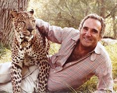 Burton Goldberg, founder of the former Mutiny Hotel in Coconut Grove and later an author and proponent of alternative medicine, frolics with a leopard on a farm owned by movie actress Tippi Hedren.