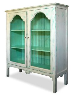 The turquoise color on the inside just makes this display cabinet pop.  Display shells, beautiful white dishes or add different shades of blue and green glass vases.