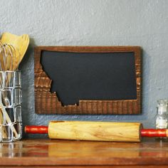 Whatever you want to say, do it with your Montana pride on these adorable state outline chalkboards. Handcrafted in Bigfork by Old Blue Designs.