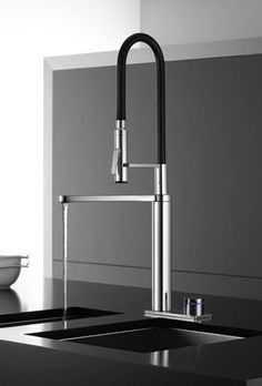I've never seen this kind of faucet within a faucet before.  I think they may be onto something here.  Love the black accent as well.