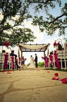 April Wedding with bright pink florals done by Wild Bunches Floral at Memory Lane Event Center