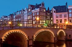 Amsterdam - A city of narrow houses, myriad canals, and flower markets, Amsterdam remains a great capital. Don't miss the magnificently restored Rijksmuseum and Anne Frank's House.