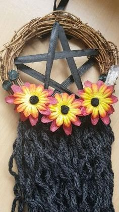 A black satin pentagram with chunky wool in a deep grey. This wall hanging features faux orange and red flowers, a clear quartz point and black coiled wire detail. Wool Wall Hanging, Altar Decorations, Chunky Wool, Dream Catchers, Clear Quartz, Black Satin, Red Flowers, Wicker, Bohemian