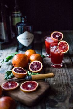 Blood Orange Negroni - the classic Italian cocktail with a splash of fresh squeezed orange juice. | http://www.feastingathome.com