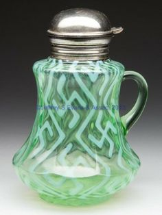 Green opalescent glass swastika nine-panel mold syrup pitcher by Dugan Glass Co. USA c. 1907