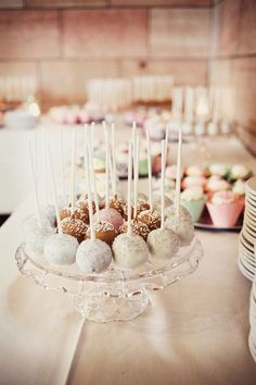Add cake pops to your candle table for an extra sweet treat. Photo by Roee. #WeddingPartyFavors