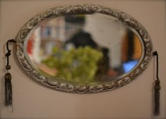 Antique French mirror with tassels - oval shaped, silver hand painted - from the Porte de Vanves brocante (flea market) in Paris