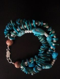 Natural Sleeping Beauty and Kingman Turquoiuse with fresh water pearls 3 strand bracelet. Handmade by Native American Jewelry Designer Cansas Roanhorse. $25.00 plus shipping