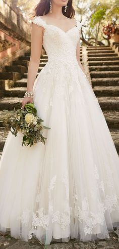 The lace wedding dress with cap sleeves is an instant classic from Essense of…
