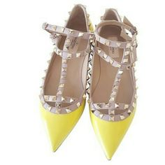 Valentino Rockstud Patent Cage Flats 100% authentic from Valentino Flats Rockstud in yellow color,  new condition never been worn still have special plastic protection.  Going well with many outfits specially with Navy Blue dress or pants.  Those are being purchased in London Harrods,  this color is very hard to find being discontinue.  Coming with original box and dust bag. This size runs small Sorry but this item can't be bundled as a discount. Valentino Shoes Flats & Loafers