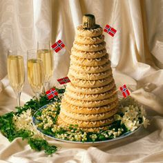Kransekake (ring cake), the traditional Norwegian wedding cake can also be found at baptisms and holiday parties, too. Made with almonds, sugar, and egg whites, it's created by stacking graduated rings of cake on top of each other to form a conelike shape. Ideally, the cake is soft and chewy, but sturdy enough to hold up throughout the ceremony.