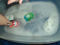 Car wash. Could use the idea for washing toys with nail brush, tooth brush, sponges, towels, etc