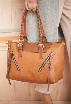 The perfect fall handbag with zipper accents and braided tassels