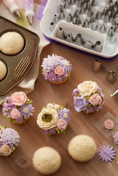 These amazing Floral Fantasy Cupcakes look like they're straight out of the garden! Blooming with stunning buttercream roses, daisies, mums and more, they are sure to make someone's day.  Featuring soft pink, ivory and violet flowers, these cupcakes would be great for a wedding shower, a spring brunch, or for Mother's Day. Use the Wilton Master Decorating Tip Set to create this lovely garden of pastel florals.