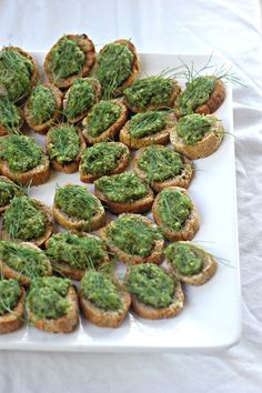 crostini bites with garlic scape pesto and fennel fronds