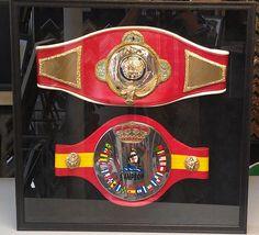 Framed boxing belts in a custom framed shadow box. Custom framed by FastFrame of LoDo.