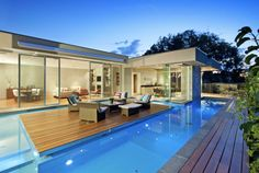 www.integratedpools.com.au ph: (03) 8532 4432 Custom designed pool with pool house #luxurypool  #floatingdeck #canny