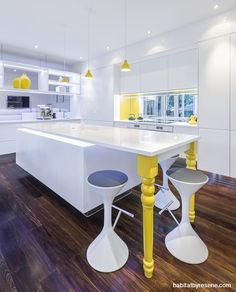 This kitchen by designer Celia Visser also uses yellow as an accent, this time in Resene Golden Dream against a white backdrop of Resene Alabaster.