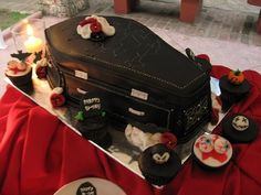 My kinda birthday cake, a #coffin with cupcakes surrounding it!