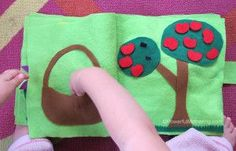 A great felt page that incorporates fine motor skills as well as transferring objects around. This apple picking quiet book page is great for toddlers as either a busy book or as a simple toddler quiet book addition. Diy Quiet Books, Baby Quiet Book, Felt Quiet Books, Quiet Book Patterns, Sewing Patterns For Kids, Toddler Books, Toddler Gifts, Book Libros, Book Page Crafts