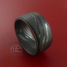 Wide Damascus Steel Ring Wedding Band Genuine Craftsmanship Made to Any Size 3 to 22. $248.92, via Etsy.