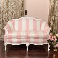 This settee features a charming French style frame with amazing floral crests.  #thebellacottage