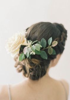 braided low updo wedding hairstyle with leaf and flower hairpiece via jen huang