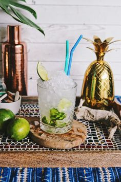 While we were in Portugal, the Caprioska quickly became our favorite cocktail! Made simply with vodka, limes, white sugar and crushed ice, this Brazilian cocktail is incredibly refreshing and tasty! Brazilian Cocktail, Parmesan, Drink Tags, Tart Taste, Vodka Lime, Chicken Curry Salad, Sugar Crystals, Metal Straws, Portuguese Recipes