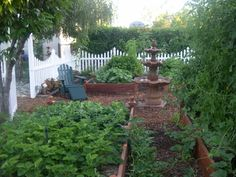 My vegetable garden, A vinyl picket fence keeps my labs out and makes a nice distinction between the veggies and the rest of my yard., An adirondack to relax.  Strawberry box in foreground, tomatoes on the right. , Gardens Design