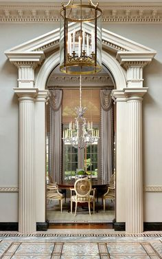 Spectacular Classical Arch in a Dining Room.