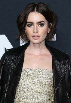 Lily Collins Photos - Actress Lily Collins attends the Saint Laurent show at The Hollywood Palladium on February 2016 in Los Angeles, California. - SAINT LAURENT At The Palladium - Arrivals Short Sassy Haircuts, Short Shag Hairstyles, Trending Hairstyles, Celebrity Hairstyles, Lily Collins, Lilly Collins Short Hair, Short Dark Hair, Short Hair Cuts, Looks Teen