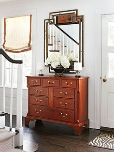 A dresser-and-mirror combo in this foyer resembles a bedroom vanity, with its abundant storage and boudoir lamps: http://www.bhg.com/rooms/rooms/entryway/front-entry-decor-ideas/?socsrc=bhgpin050714versatilevanity&page=7