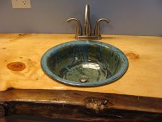 Hand-make and wheel-thrown by artist Brigette Kinney of Dragons Breath Pottery.