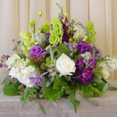 white, green, and purple centerpieces
