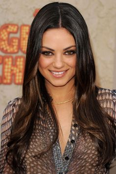 Ombre: Mila Kunis wears her glossy long brunette locks with a subtle dip-dye, to stop the style getting boring.