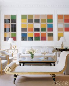 Architect Lee F. Mindel merged the classic with the contemporary in the living room of a 1902 Manhattan townhouse, grouping 26 color studies by Günther Förg into blocks that fit within the room's traditional molding.