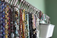 Storage solution for necklaces -- get cheap rail and hooks at IKEA.