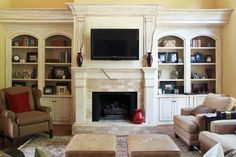 Love the crown at the top of the built-ins with space to the ceiling
