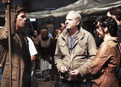 This week's Entertainment Weekly  features the first look at Catching Fire! Here is a behind the scenes picture of Liam Hemsworth, director Francis Lawrence, and Jennifer Lawrence.