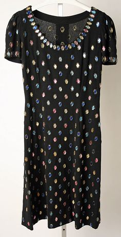 "Black wool ""Subway"" cocktail dress with faux gem embellishment, by Norman Norell, American, 1942."