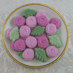 This listing is for-- 24 Open Rose & 12 Spearmint Leaf (total of 36) shaped sugar cubes in the following colors:  Roses: Parisian Pink (light) Fuchsia Fields (dark)  Spearmint Leaves: Bayberry Green (light) Willow Tree (dark)  INGREDIENTS: Unflavored 100% Pure Cane Sugar Verified Non-GMO, water & food coloring  SIZE: Each Open Rose = 1/2 teaspoon of sugar Each Spearmint Leaf = 1/2 teaspoon of sugar  PICTURES: Last two pictures of sugar on teaspoon show you the relative size only. The colors…