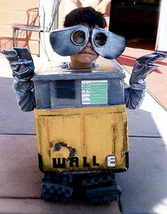 "Benjamin was four when he went as WALL-E for Halloween. But instead of spending money on a premade costume he'd wear once, his father showed him how to make his own out of used computer boxes and packaging material. ""Over the course of three weeks, we measured, cut, sliced, painted and choked on fumes to construct our beloved WALL-E,"" Anthony Shafer explained of the project. - GoodHousekeeping.com"