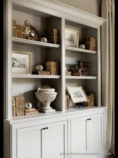 White Bookcases for guest room/library. Store games etc in the cabinets below