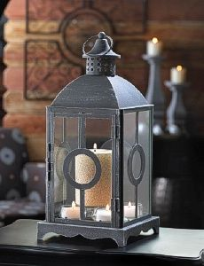 Excite the night with fantastic candle light as it shines through this gorgeous candle lantern. It features a brushed pewter-like finish, clear glass panels adorned with a classic circle design, and cupola on top that has an over-sized hanging loop attach Glass Tealight Candle Holders, Candle Lamp, Glass Votive, Candle Lanterns, Clear Glass, Candle Box, Lanterns Decor, Grey Candles, Party