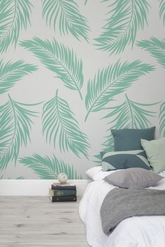 Rest your head and dream of sun-soaked interiors with this tropical wallpaper design. Illustrated ferns look as if they're falling slowly through the warm summer's air, giving your home a relaxed vibe. This wall mural is the perfect backdrop to bedroom spaces, making them feel bright and airy.