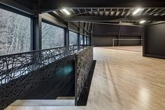 Jan Henrik Hansen adds futuristic badminton hall to Swiss sports centre Light Architecture, Contemporary Architecture, Interior Architecture, Badminton, Youth Center, Sports Complex, Interior Rendering, Iron Steel, Sports Clubs