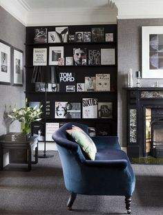 moody tones, black shelf, Vintage Magazine Covers used as Artwork on the Black shelving.