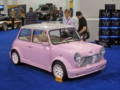 Pink MINI, bedazzled with rhinestones. I want.